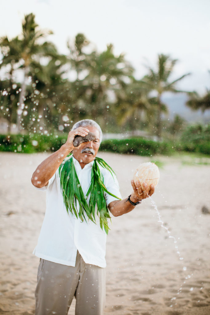 Opening coconut on the beach.