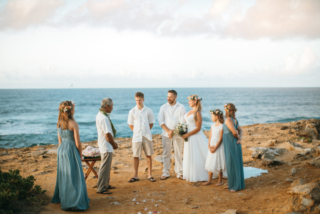 Gathered for wedding on the beach in Hawaii.