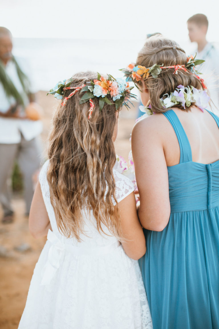 Young girls with leis and flowers.