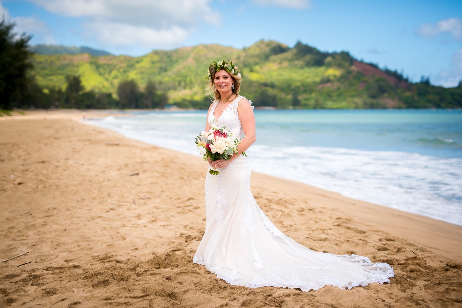 Bride with flowers on the beach.