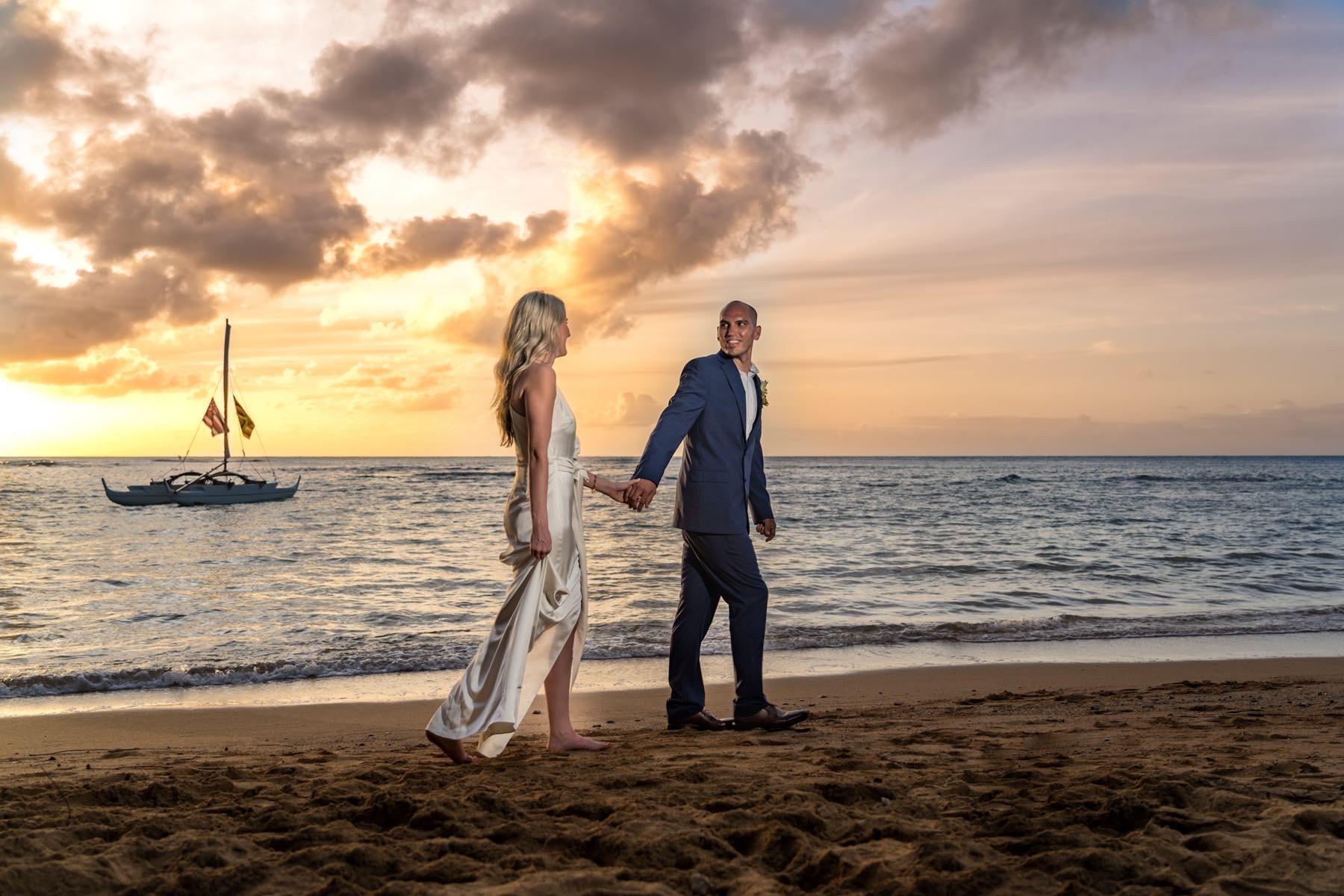 Sheena and Michael walking on the beach.