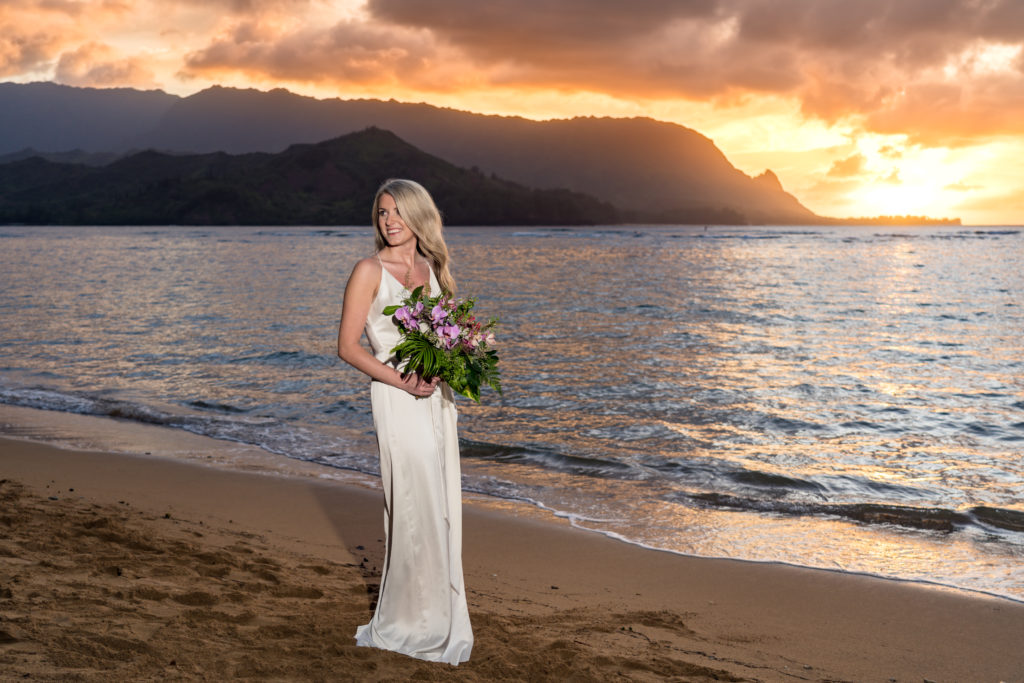 Bride on the beach at sunset.