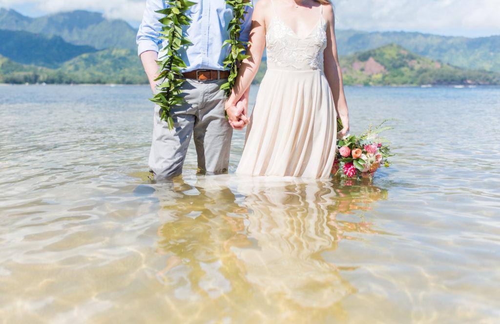 Bride and Groom in water in Kauai.