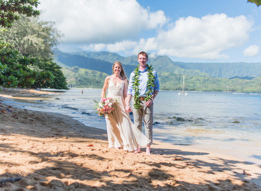 Bride and groom on the beach in Hawaii.