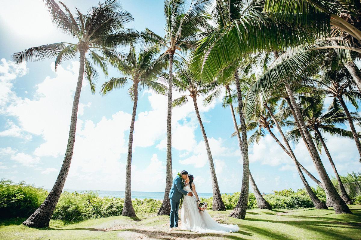 Gabriel & Darlenne getting married on the beach in Hawaii.
