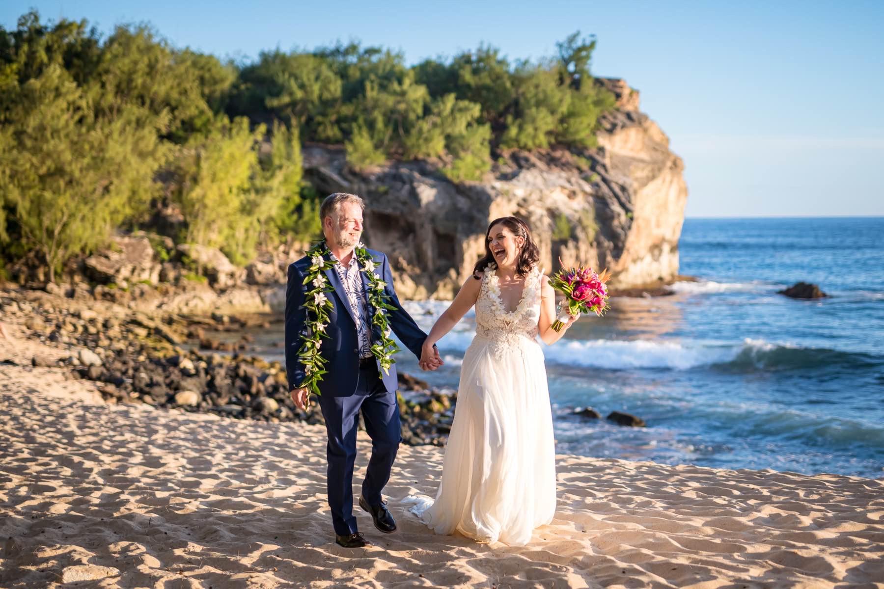 Corina & Kipp walking on the beach in Kauai.