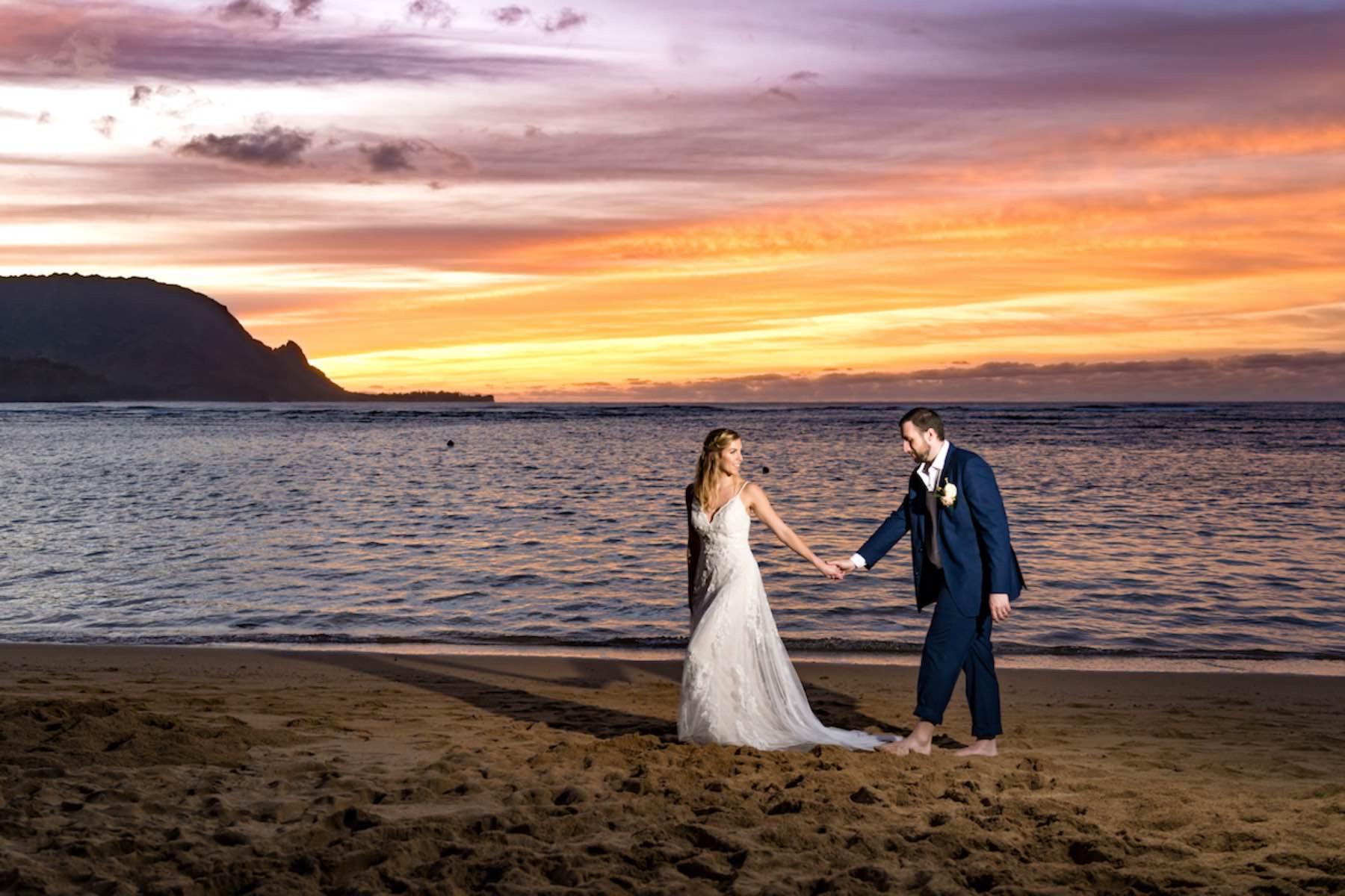 Sarah & Brian on Hawaiian beach at sunset.
