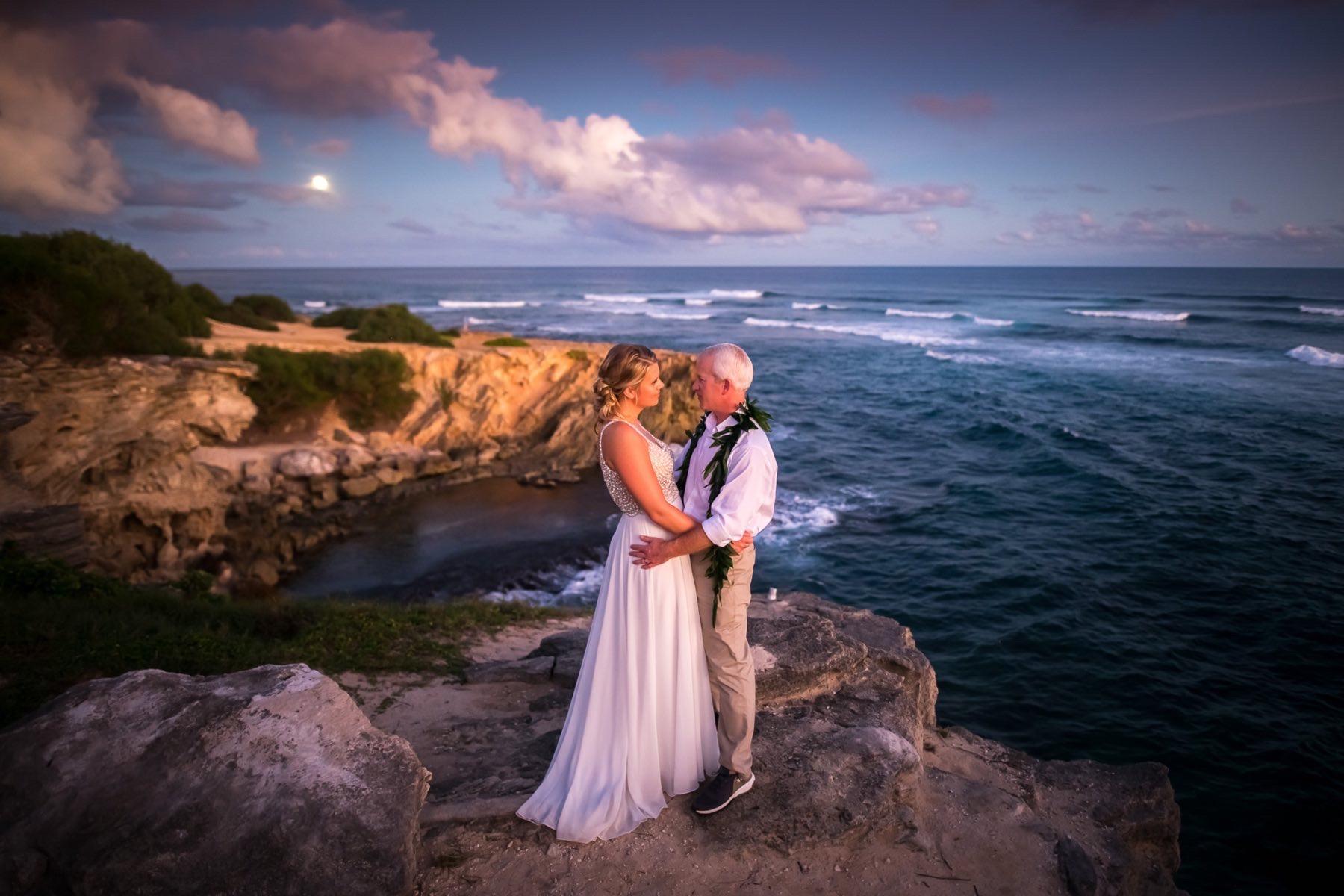 Todd & Angela on rocks overlooking the ocean.