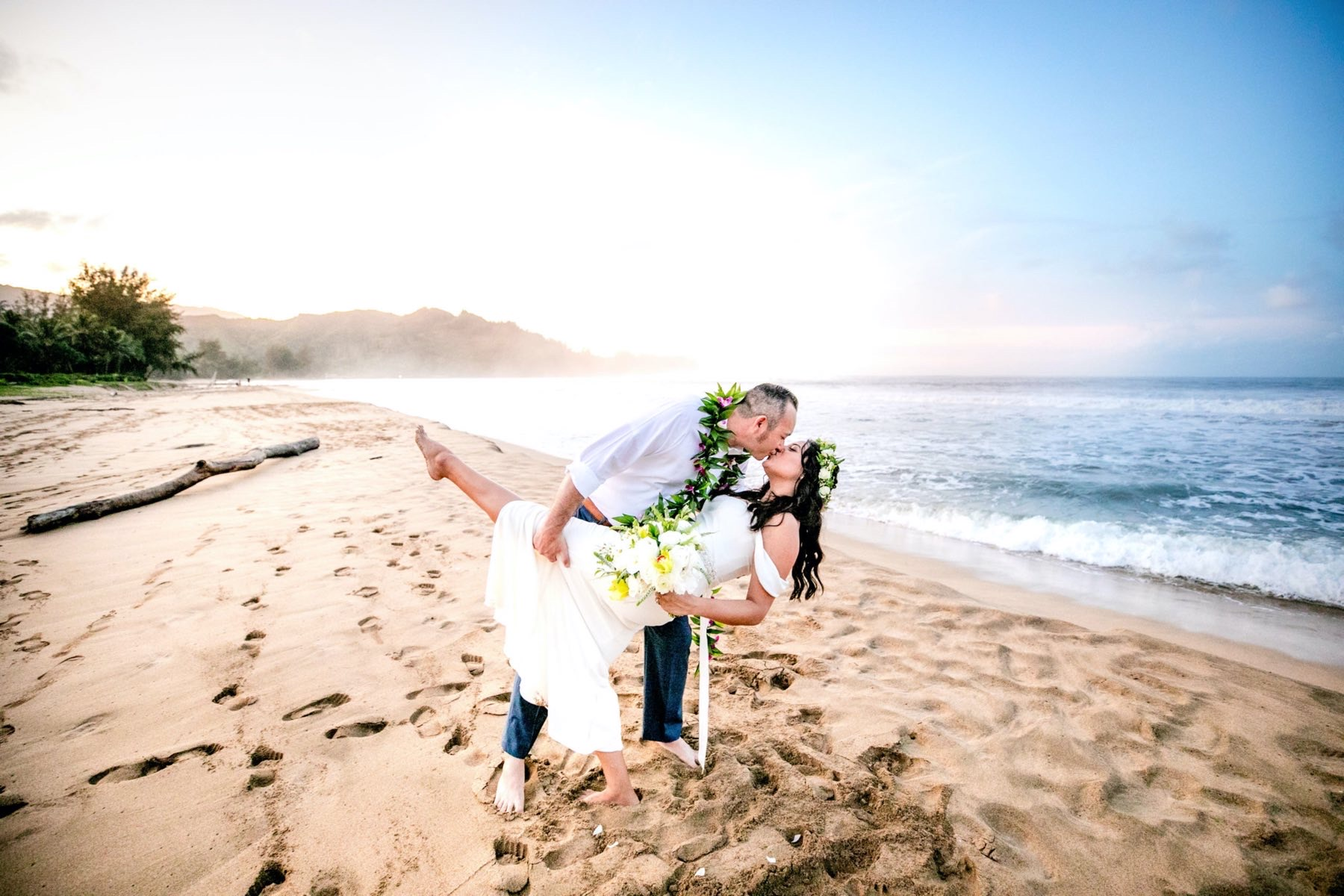 Cassandra & Alex on the beach in Kauai.