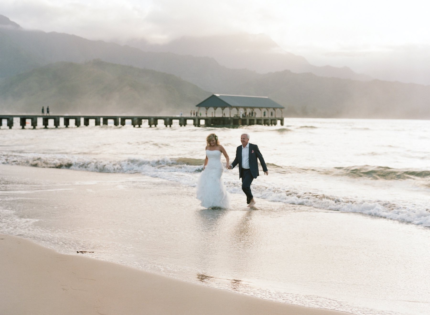 Jim & Rebecca walking on the beach in Kauai.