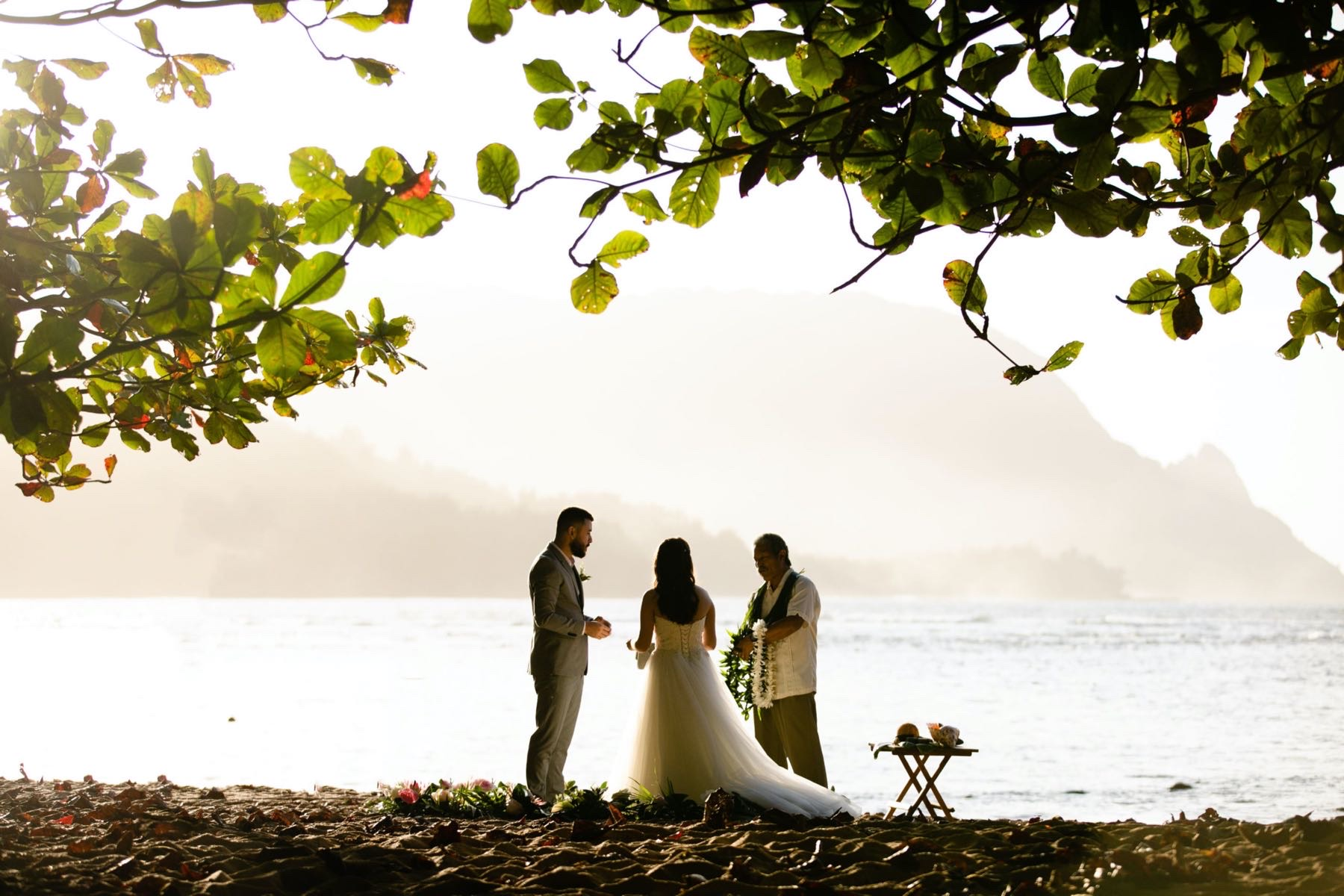 Paige & Jose getting married on the beach in Kauai.