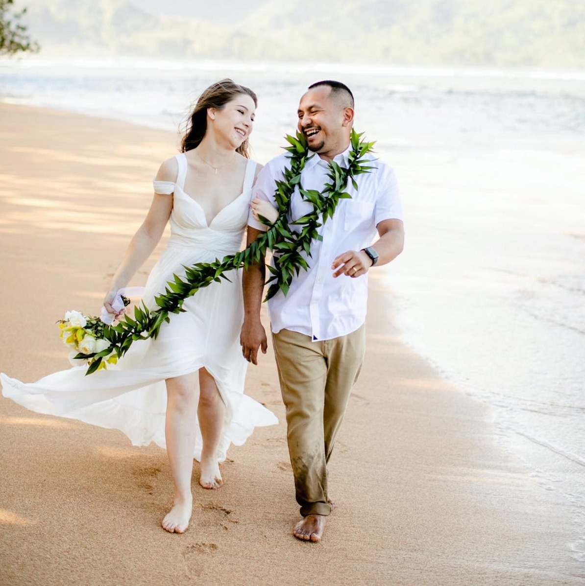 Jaclyn & Dylan walking on the beach in Kauai.