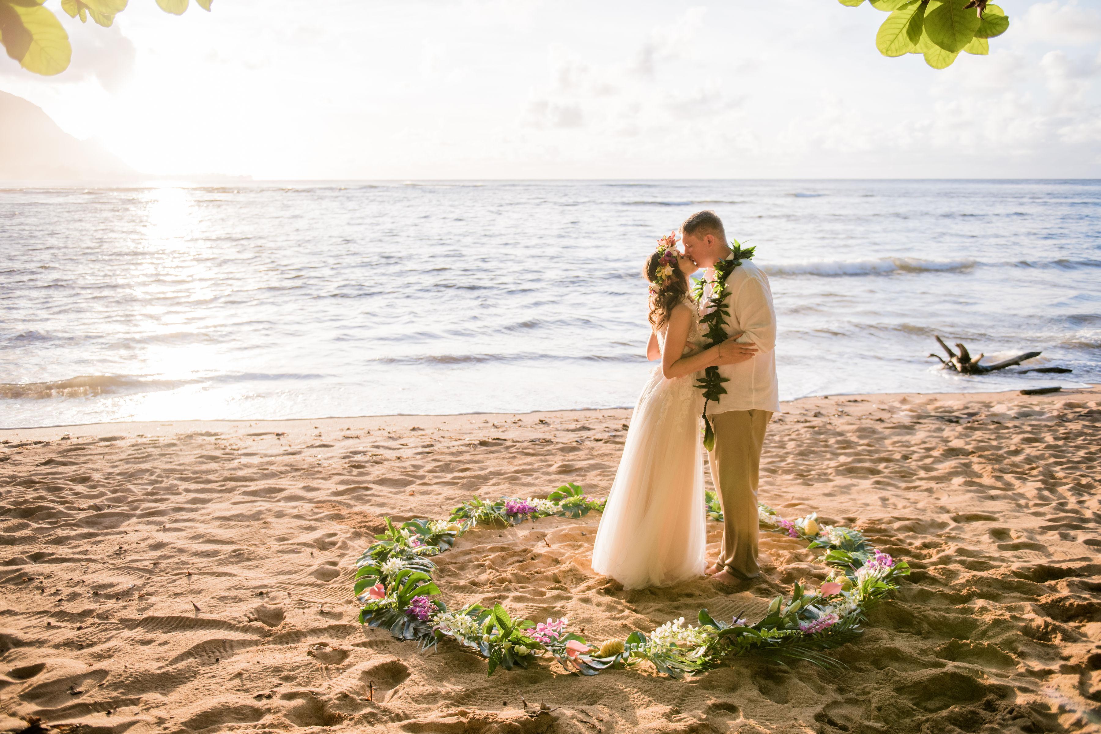 Puu Poa beach wedding on Kauai sunset