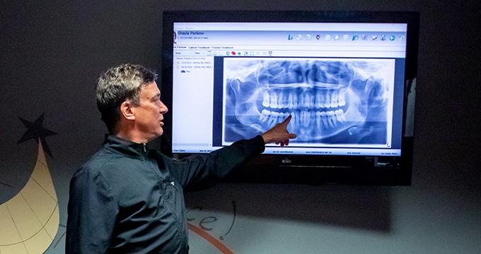 Dr. Steve Kristo explains orthodontic treatment to patient