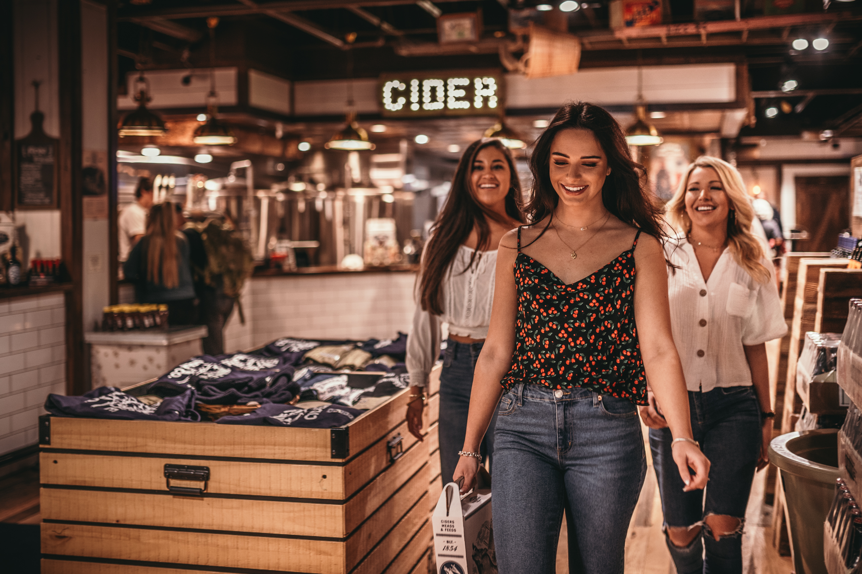 Girls walking out of Tennessee Cider Company with products they just purchased - Tennessee Cider Company offers many products other than cider for your enjoyment in Gatlinburg and Sevierville Tennessee