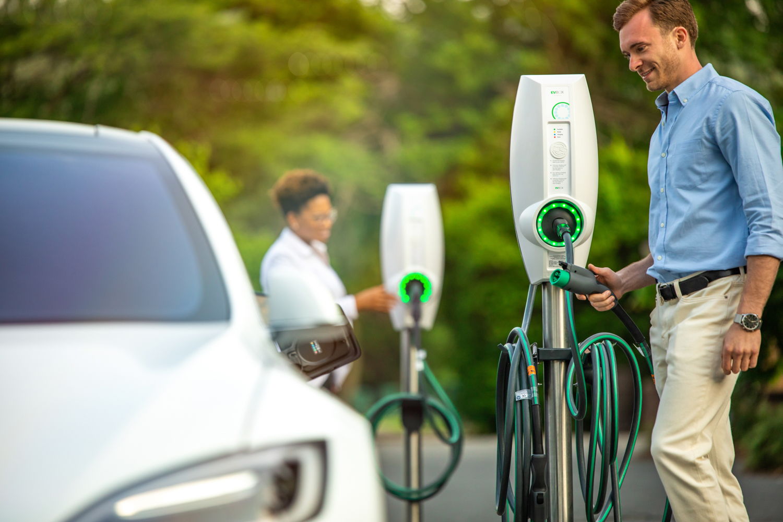 man charging a car