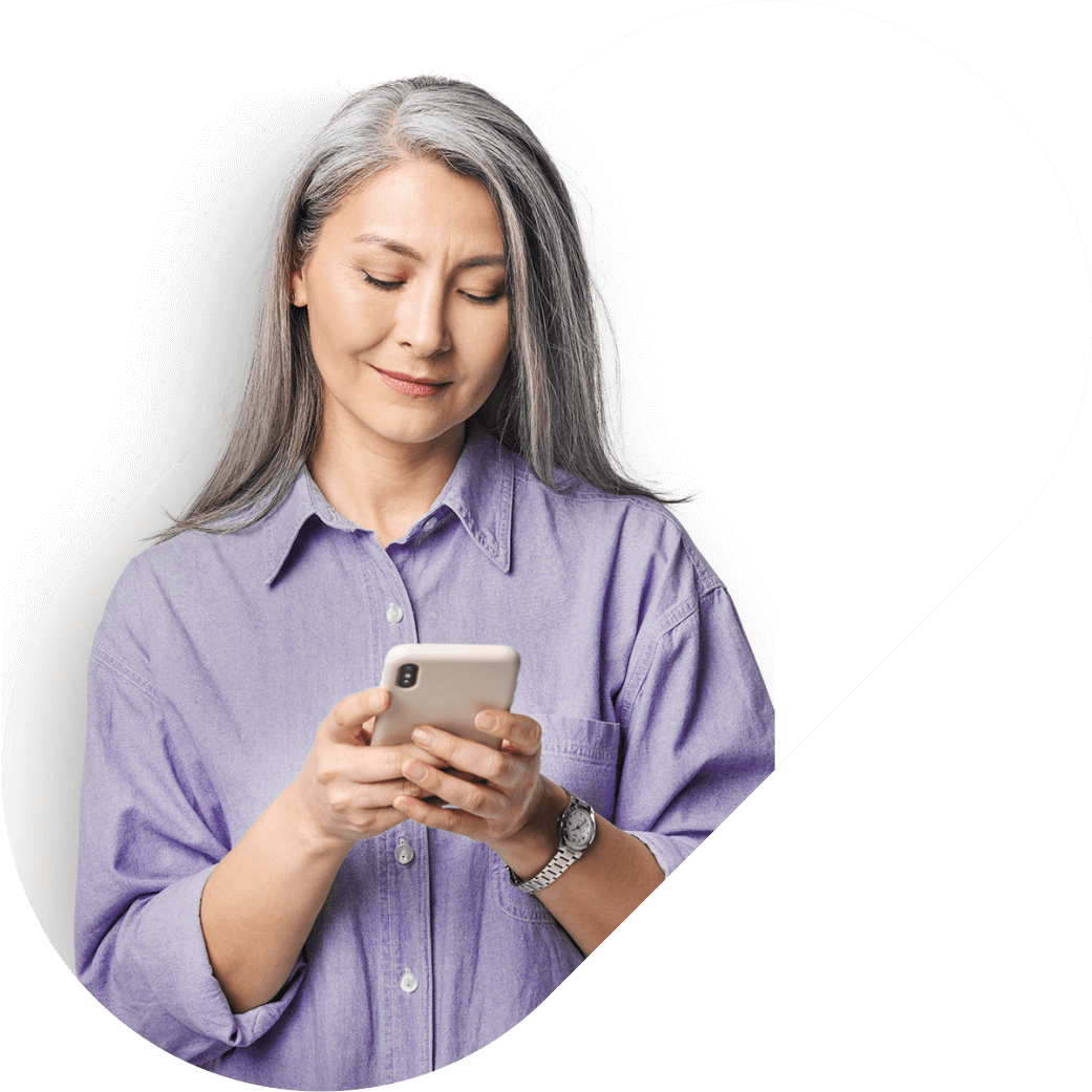 lady with gray hair holding phone