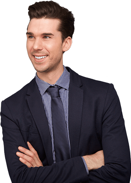 Man in suit smiling with arms folded.