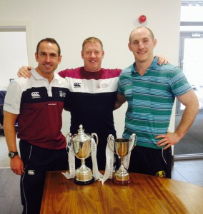 Mark, Ally, and Andy show off the trophies
