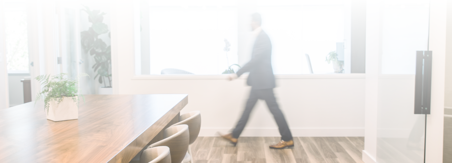 person walking in the Allium Financial office