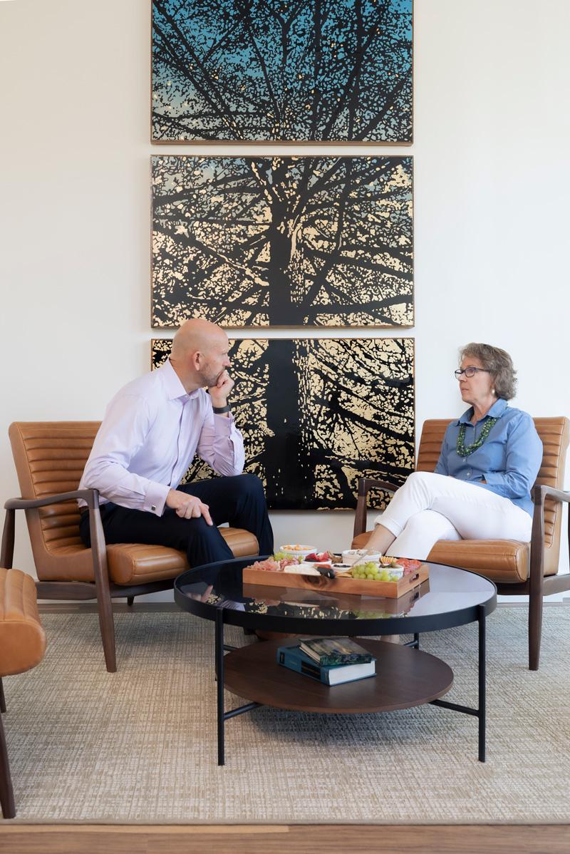 2 financial advisors talking