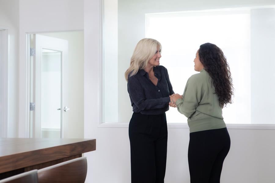 two Allium Financial employees talking