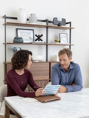 an Allium Financial advisor talking to a client