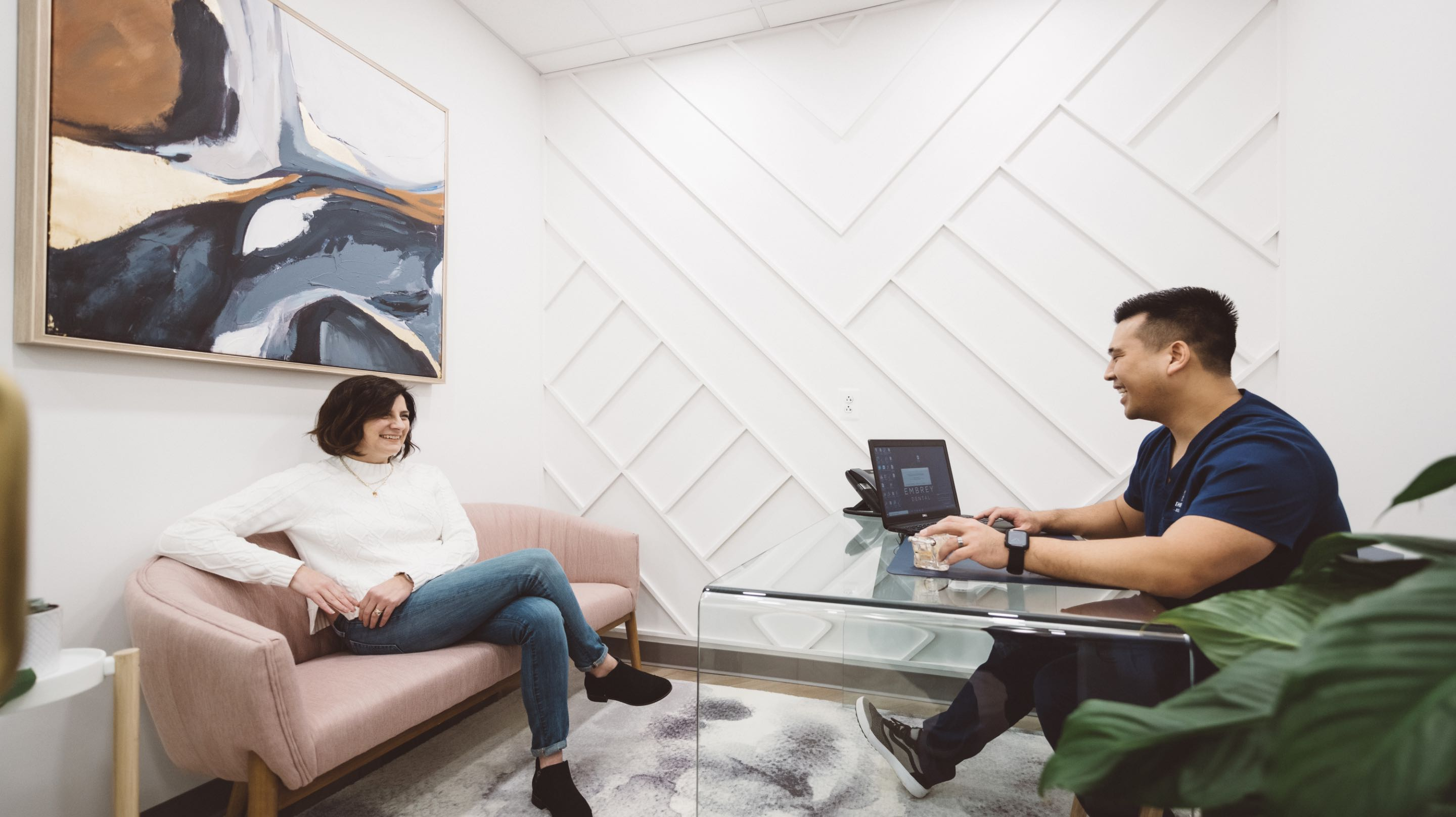Photo of Dr. Peter Lim and a patient talking in a consultation room