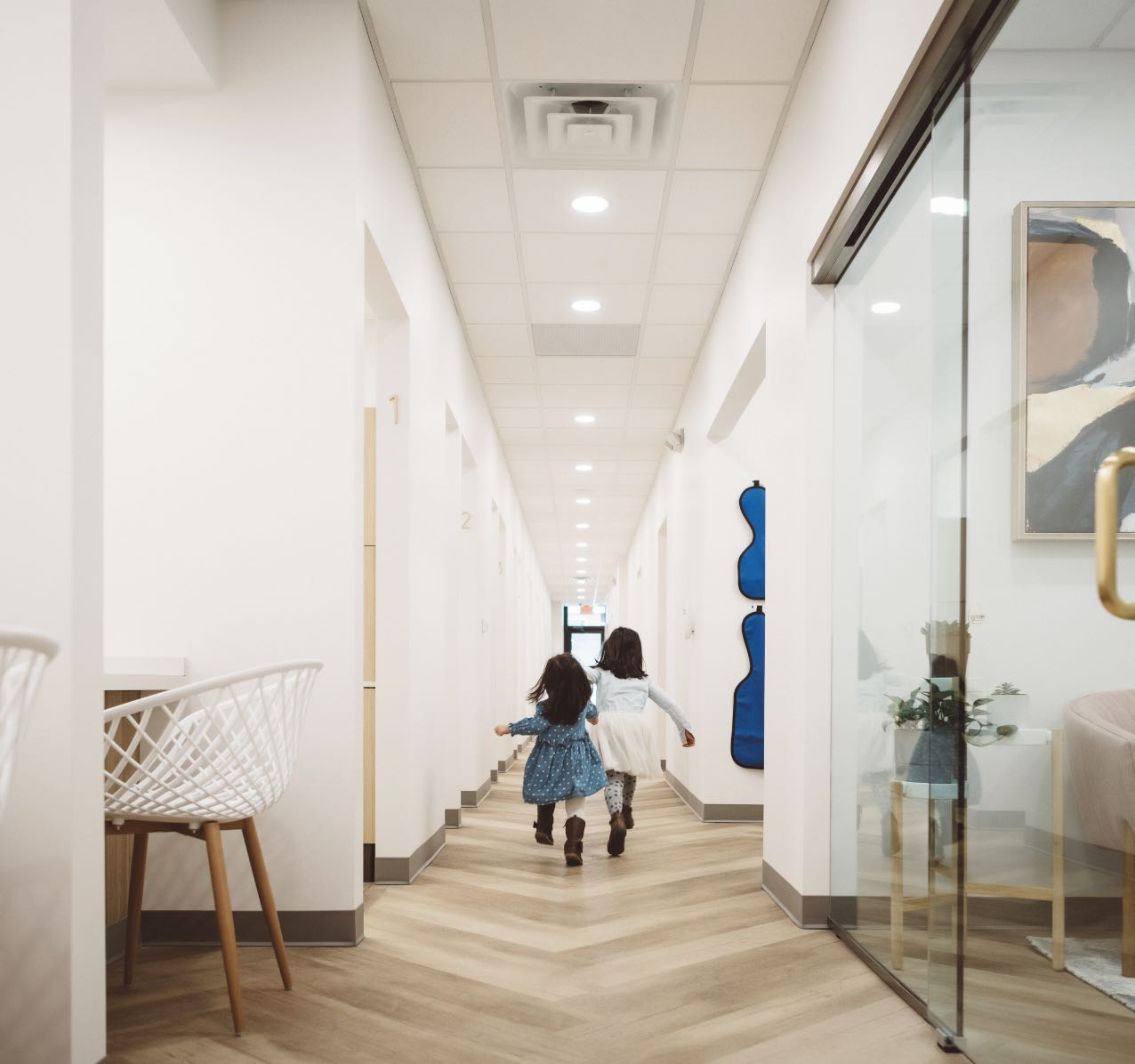 Photo of two young patients walking down a hallway together