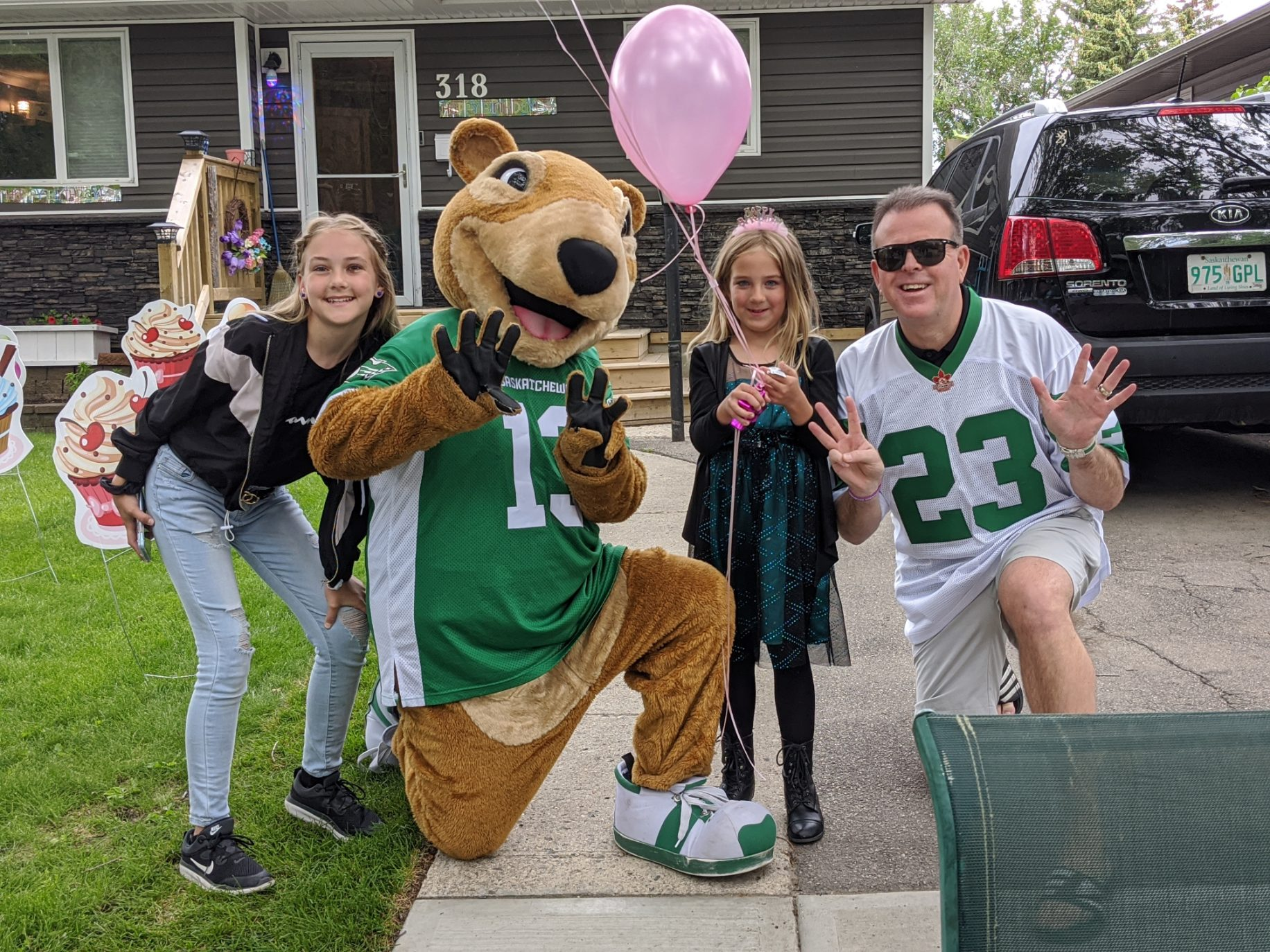 Saskatchewan Roughriders mascott with kids