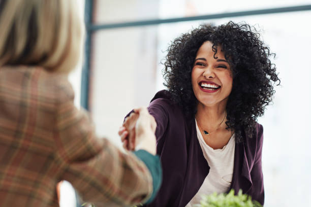 Wonderful, I'll see you first thing on Monday Shot of two colleagues shaking hands during a meeting at work interview stock pictures, royalty-free photos & images