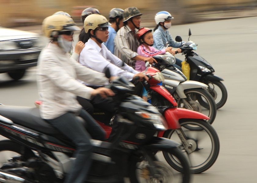 Sherry adopted the popular mode of transport in Vietnam, which is motorbikes