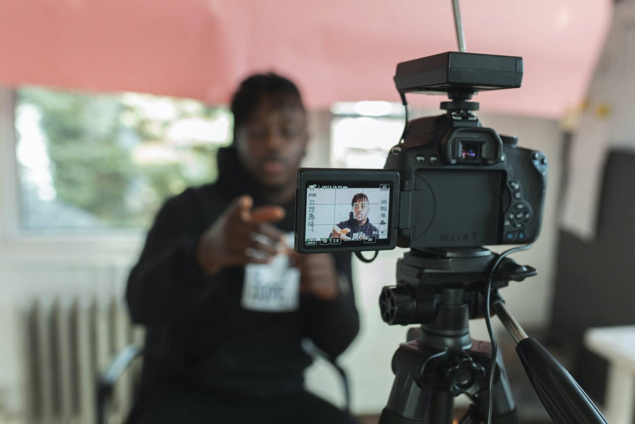 An image of a photographer in action, previewing an article which gives creators everything they need to succeed.