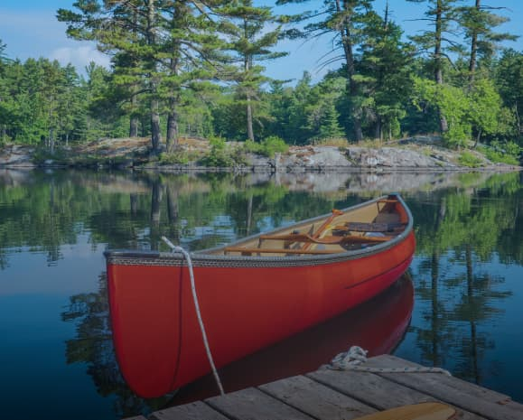 A canoe in a large, clean water lake