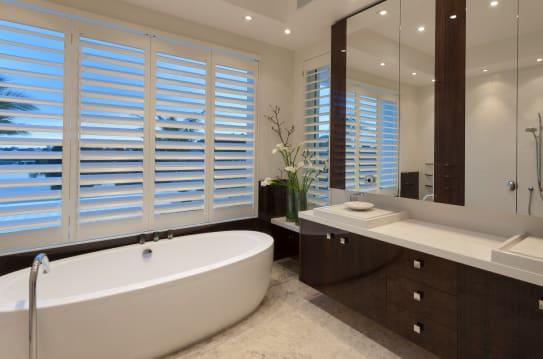 Modern bathroom with double vanity and bathtub