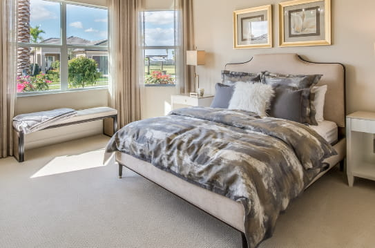 A beautiful bedroom with side chair
