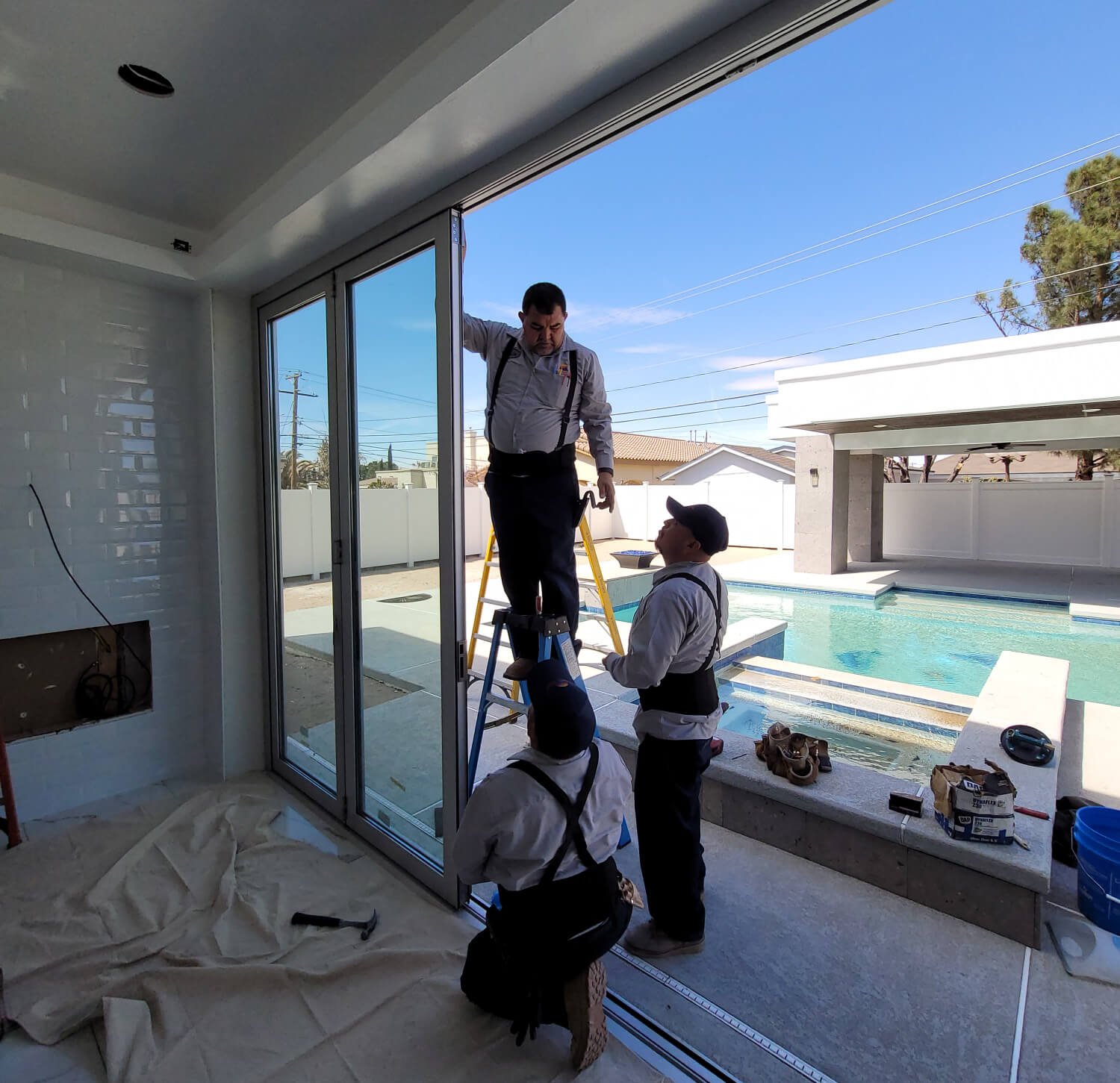 Southwestern Home Products' In-house install team working on custom glass doors