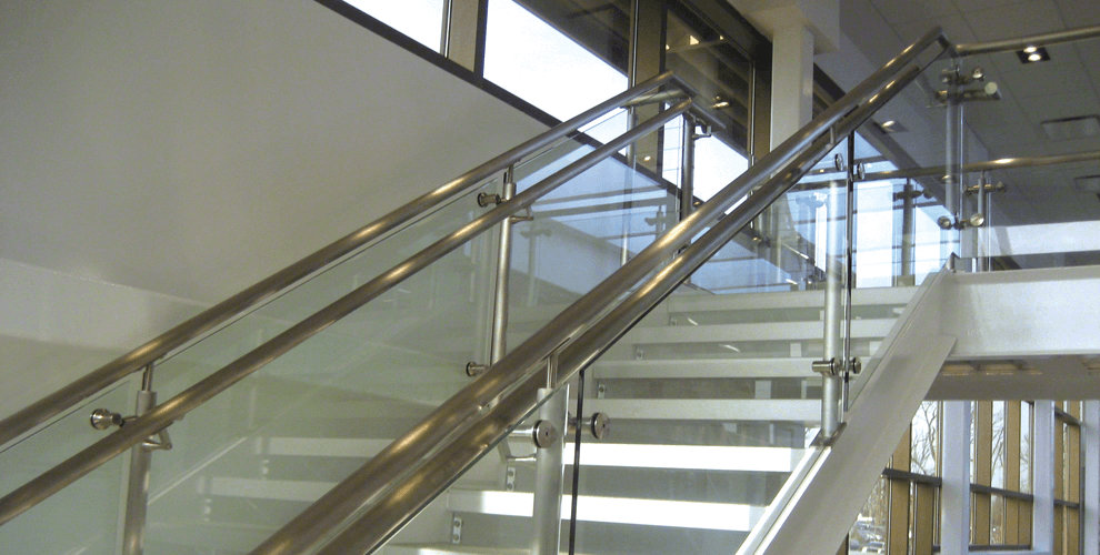 Custom luxury glass stair rails for home or office by Southwestern Home Products