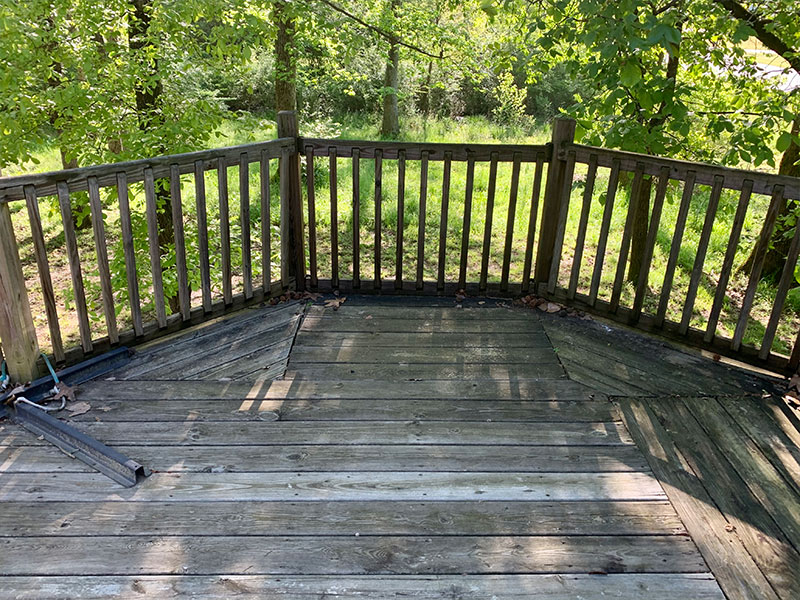State of a deck in Arkansas before a soft wash.