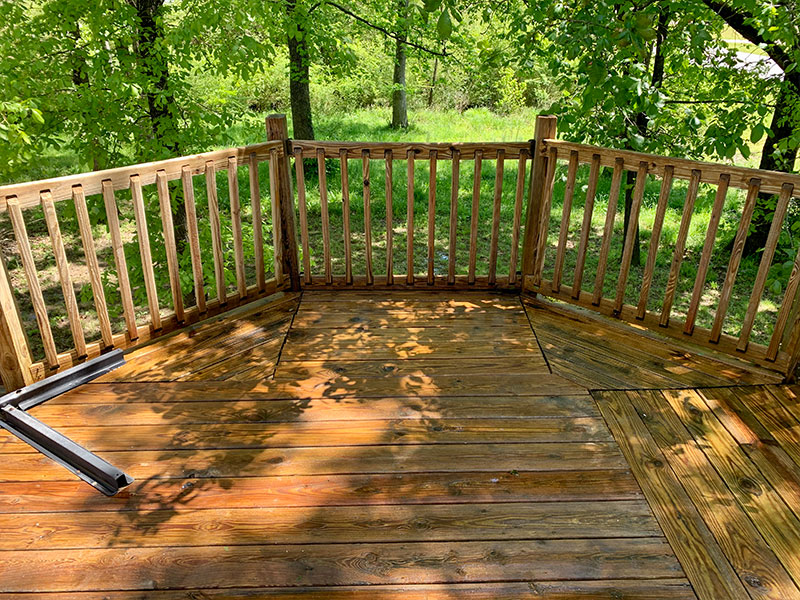 State of a deck in Arkansas after a soft wash.