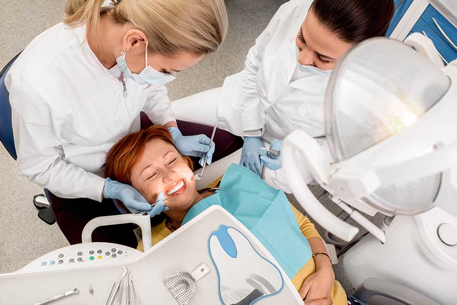 Patient smiling while she receives dental sealants in St. Louis Park.