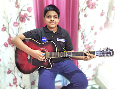 Little Master Kid Playing Guitar