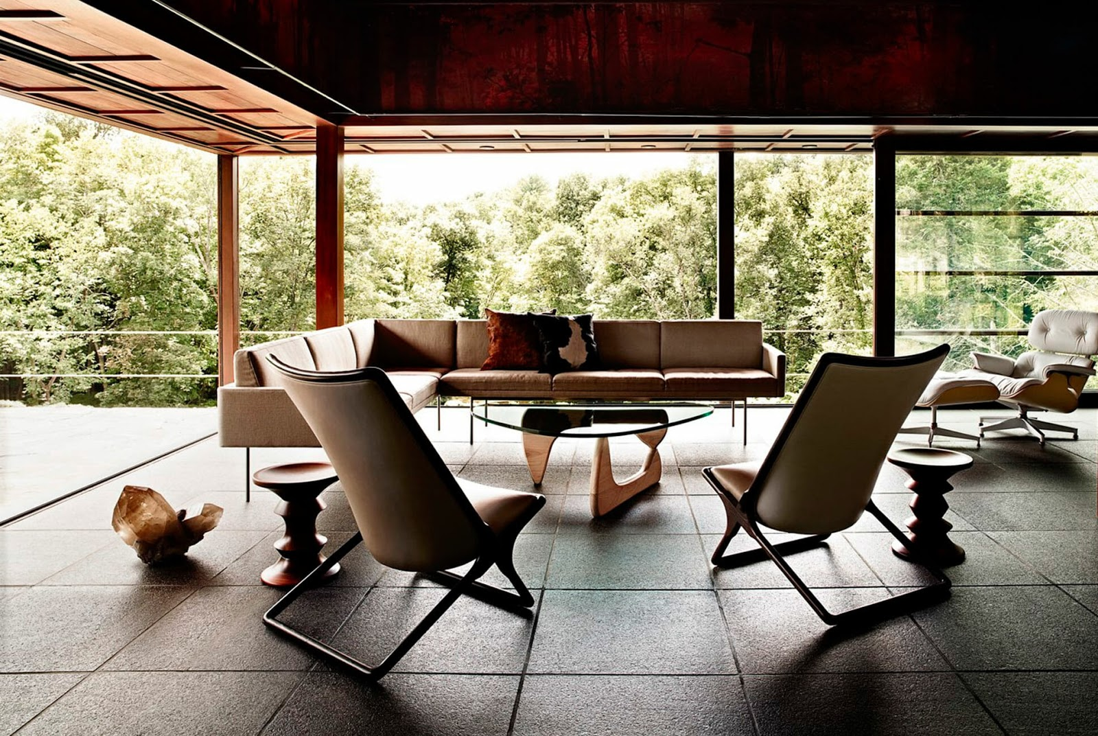a Noguchi triangular coffee table in the middle of the room