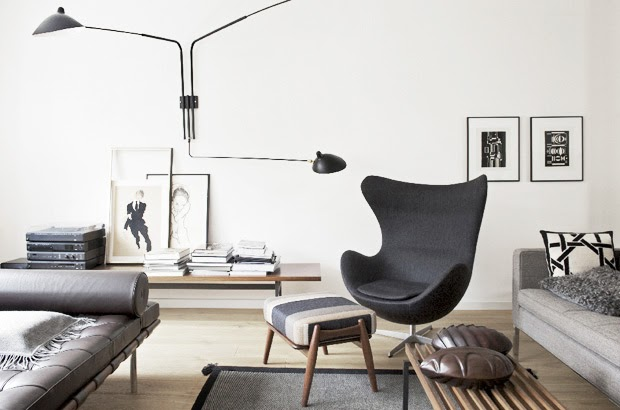 a black egg chair and ottoman in a living room