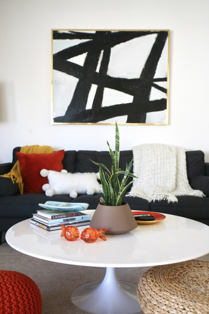 the tulip coffee table in front of a couch