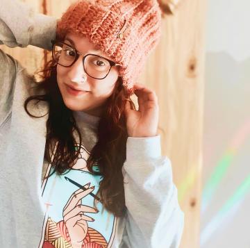 A fan wearing her Bonfire X Pink Sheep Design merch