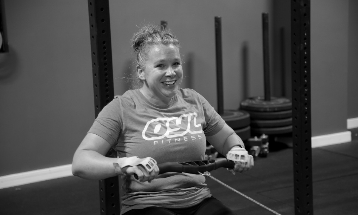 Woman smiling in Oyl Fitness