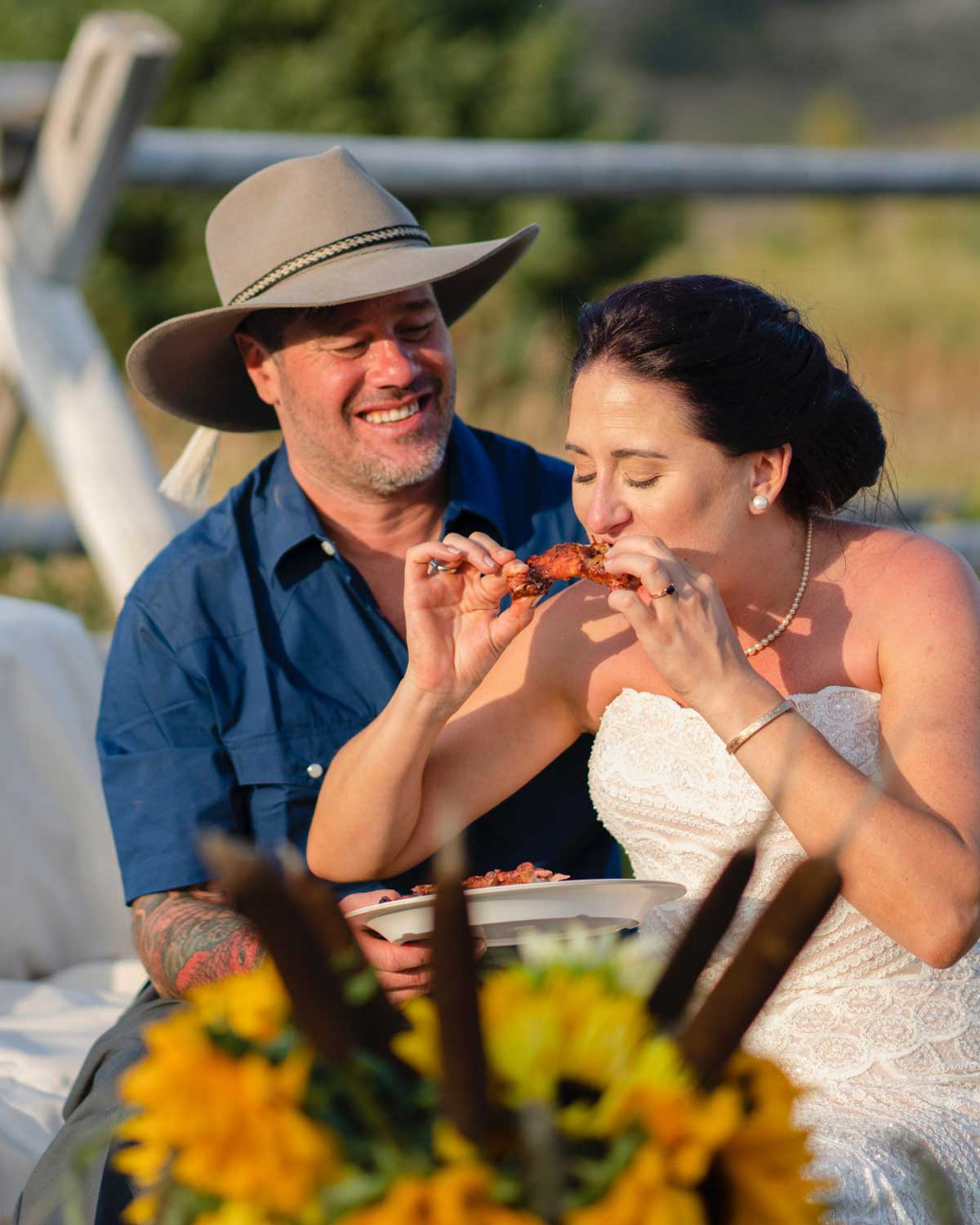 Riverhouse event photography showing a couple eating BBQ together