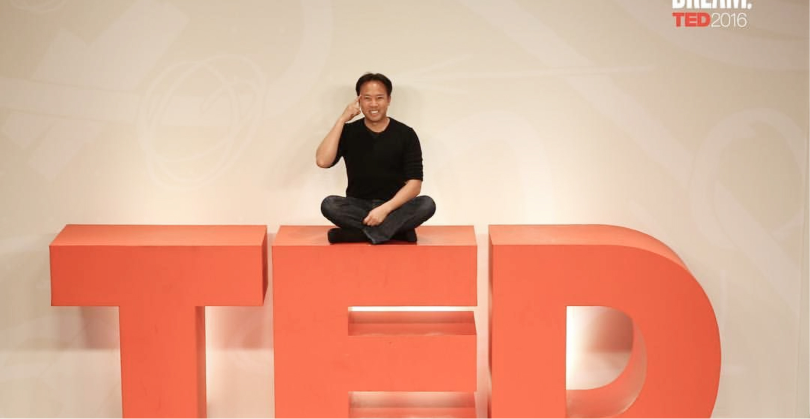 Jim Kwik siting on Ted Logo