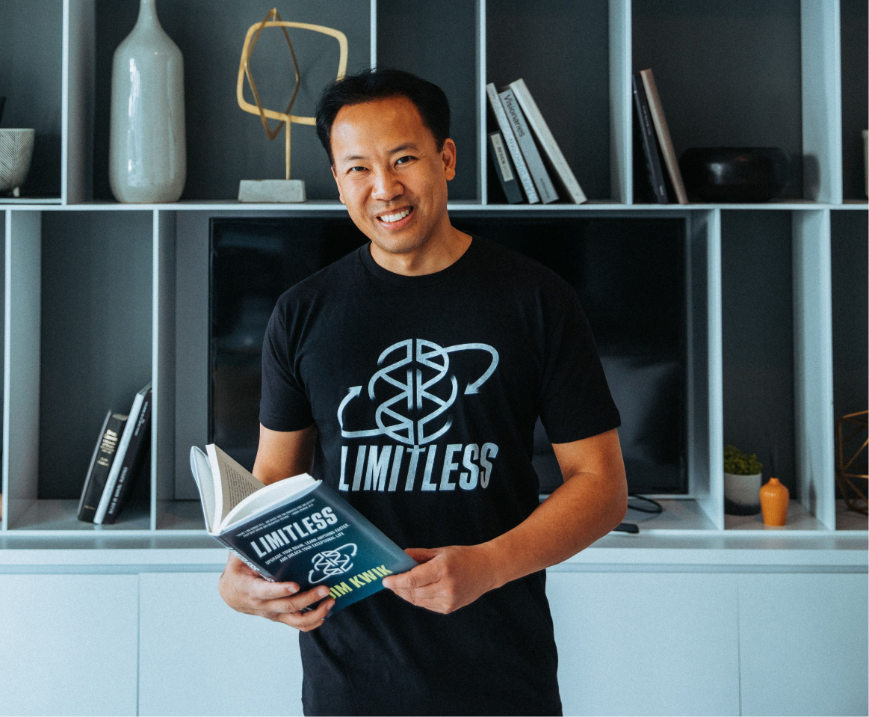 Jim Kwik holding Limitless Book